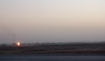 In the background, Kirkuk. In the foreground, a flare burning gas that's generated as a byproduct of oil production.